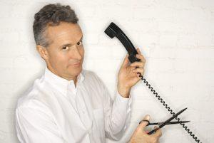 Man cutting telephone cord
